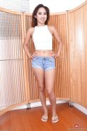 Petite Latina girl Mila Jade posing topless in denim shorts