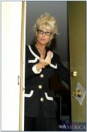 Mature teacher in glasses Vicki Vogue playing with a rubber cock