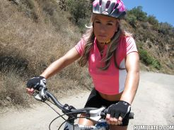 Teen babe Kara Novack rides a bike outdoor and flashes her tiny tits