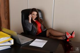 Eruo office worker Julie Skyhigh shows off her curvy figure at work