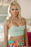 Busty Marsha May looks provocative clothed and after stripping