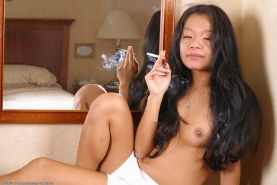 Amateur Asian solo girl unveils tiny tits while smoking cigarette #52009729