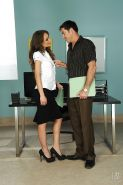 Sophie Lynx gets her shaved pussy licked and shafted hardcore in the office