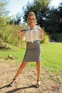 Busty sex slave dominated outdoors by blonde lesbian in skirt and glasses