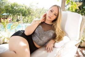 Blonde pornstar AJ Applegate spreading shaved pussy outdoors