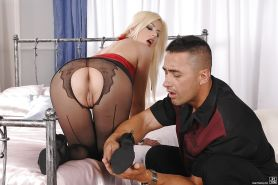 Platinum blonde Jessie Volt giving footjob to big dick in ripped pantyhose