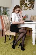 Clothed lady Tina Kay is revealing her body in glasses and stockings
