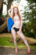 Redhead pornstar Ella Hughes flaunting nice ass outdoors in cosplay outfit