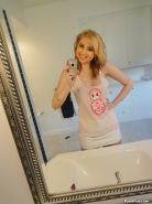 Blonde babe Molly Bennett does sexy self-shots in the bathroom