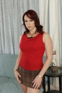 Milf babe with big tits Nicki Hunter loves undressing in her living room