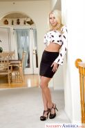 Gorgeous blonde MILF Katie Morgan posing fully clothed in black skirt