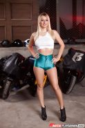 Hot motorcycle loving blonde poses in hot pants and white mid-riff shirt