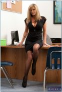 Horny MILF babe Kristal Summers poses naked on high heels in office