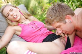 Tiny blonde teen Nicole Ray riding atop cock in the back yard