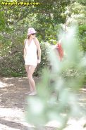Amateur babe Ashlyn Lee caught undressing in the forest by voyeur