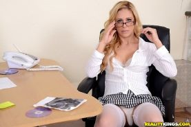 Blonde office milf Cherie Deville in hot stockings and sexy skirt
