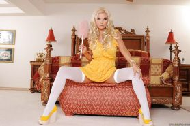 Voluptuous MILF in stockings Brittany Andrews stripping and spreading her legs