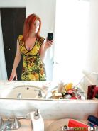Amateur redhead girl Rainia Belle makes sexy, amusing self shots