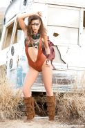 Centerfold model Gia Ramey-Gay posing outside in cosplay attire and boots
