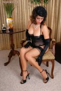 Fashionable mature Roni showing off in sexy black corset and stockings
