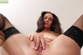 Dark haired mature babe Genevieve Crest showing her saggy tits #51773095