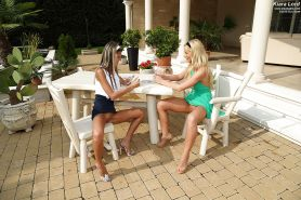 Young girl Keira Lord and lesbian girlfriend making out outdoors