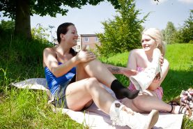 Amateur lesbian couple Jade S and Lena D fingering each other outdoors