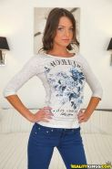 Clothed amateur babe Foxy Di is made for sensitive posing on camera