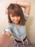 Clothed teen Riley Reid does some sexy self shots while in a toilet
