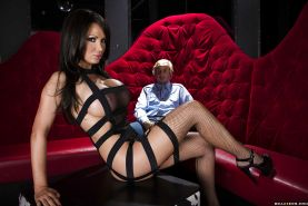 Busty vixen in stockings Nikki Benz gives a blowjob and gets slammed