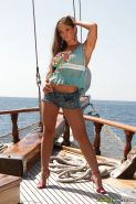 Pornstar babe Rita Faltoyano exposing her bare hooters on the yacht #55366878