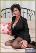 Mature bombshell Deauxma denudes huge juggs and poses in stockings