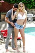 Busty European pornstar Natalia Starr blowing cock outdoors in shorts
