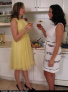 Horny mature lesbians kissing and caressing each other in the kitchen