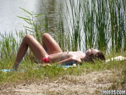 Topless hottie Riley Reid gets caught on voyeur video tanning outdoor