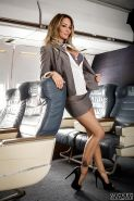 MILF pornstar Jessica Drake disrobing to masturbate on airplane in high heels