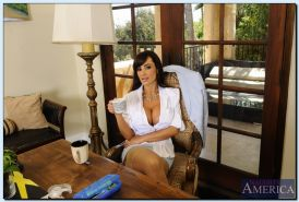 Ravishing mature teacher Lisa Ann getting naked and exposing her twat