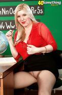 Seductive school teacher Venice Knight strips nude and takes off her pantyhose