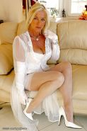 Stunning blond babe over 50 Amazing Astrid smoking a cigarette in stockings