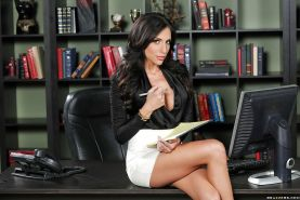 Brunette Jaclyn Taylor is posing topless right in the office!