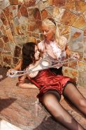 Blonde domme Amazing Astrid puts her brunette slave in stock restraints