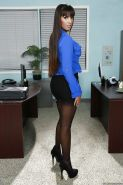 Latina office babe Mercedes Carrera teases her big tits in stockings