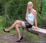 Outdoor posing scene featuring non nude lady Alexis in tight shorts