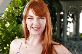 Redheaded babe Marie McCray revealing hairy pussy and big tits outdoors