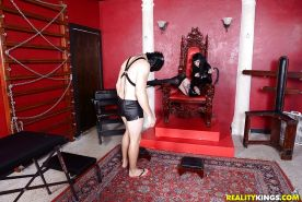 Dark haired Goth Freyja Van Siren bangs male submissive in latex attire