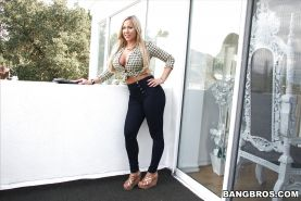 Curvy blonde bombshell Olivia Austin bending over and spreading