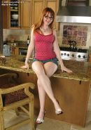 Cute redhead Marie McCray in shorts & lace underwear toying pussy in kitchen