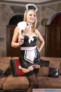 Blonde maid Anikka Albrite striking naughty poses in uniform and hosiery