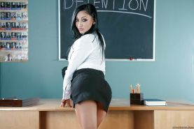 Naughty teacher Audrey Bitoni strips naked after class to expose big tits