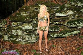 Exotic MILF babe Barbi Sinclair poses in the woods wearing leopard patterned lingeire and small black thongs.